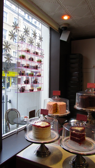 cakes in the window at hummingbird bakery in south kensington